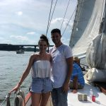 Young couple sailing on sunny summer day