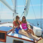A mother and daughter enjoying the sun on a sail