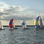 Colorful sailboats on the bay