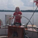 Young lady learning how to steer the boat