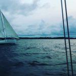 Schooner sailing through cool dark blue cloudy day