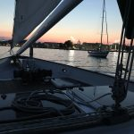 Dusk aboard the schooner looking at the Naval Academy