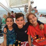 Three young people enjoying their sail