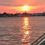 Sunset shining over Annapolis Capital building and water