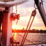 Naval Academy framed through the sails at sunset