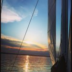 Sailing into the sunset with calm waters