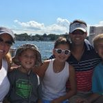 Smiling family sailing on a sunny bright day