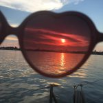Sunset viewed through sunglasses from the boat