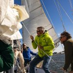Onboard the Schooner hoisting the Mainsail