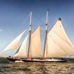 Schooner under sail with blue skies and deep blue water