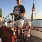 Guest and little blonde toddler steering the schooner