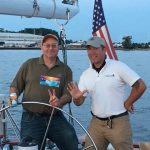 Captain and guest enjoying steering the boat