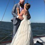 Bride and Groom getting married on schooner
