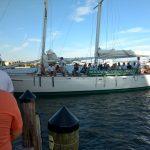 Schooner sails down and motoring into port