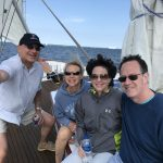 Four people smiling and having fun on the schooner