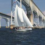 Schooner flying under the Bay Bridge
