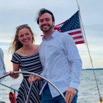 Smiling couple steering the schooner