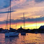 Sail boats moored at sunset with Capital Building in background