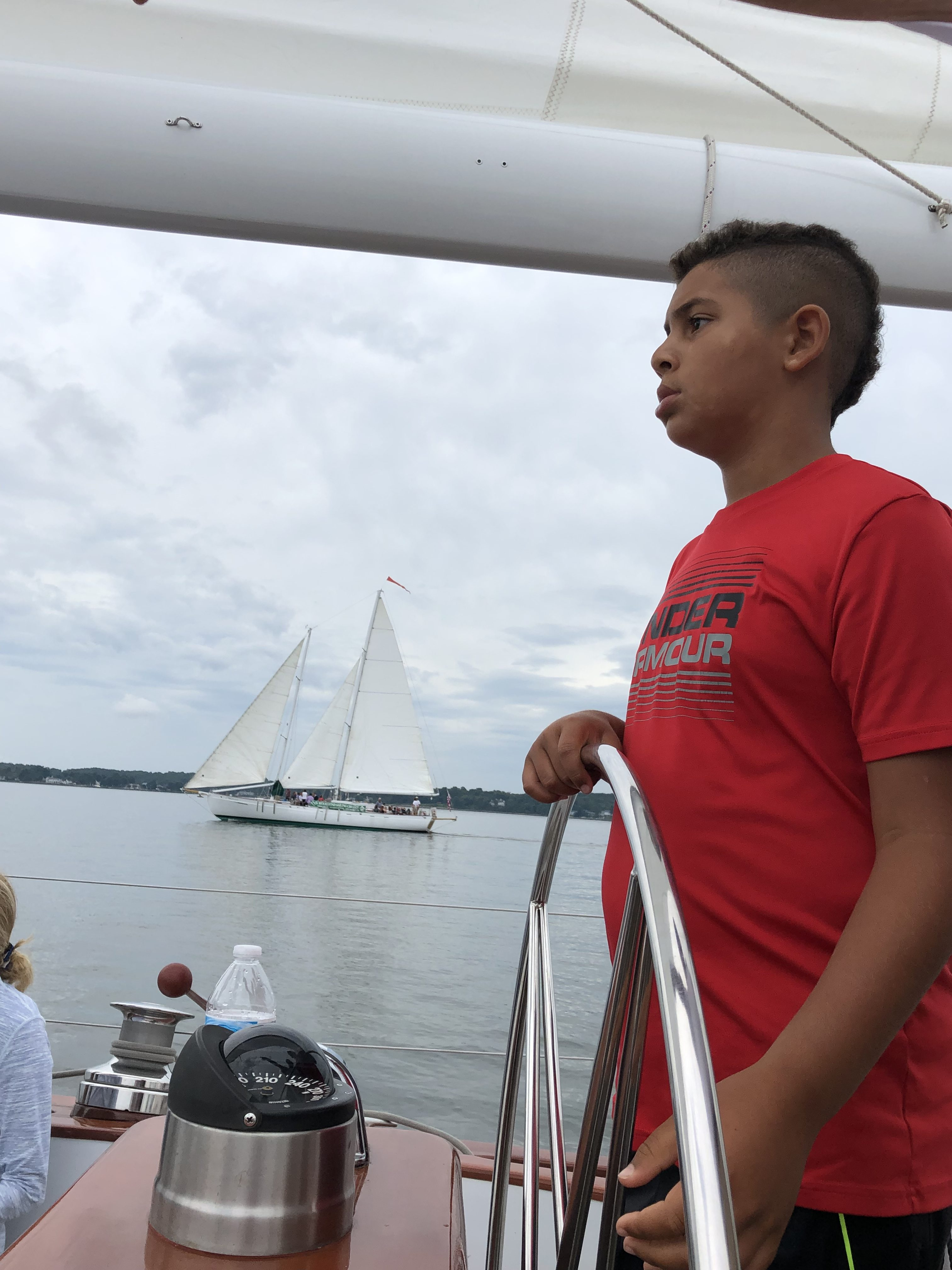 Young man learning to skipper the schooner