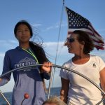 Captain teaching young lady how to navigate the Chesapeake
