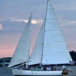 Woodwind schooner sailing at sunset