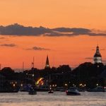 Annapolis harbor at dusk with Capital building lit up