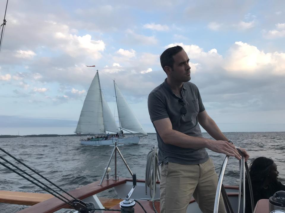 Having fun steering the sail boat