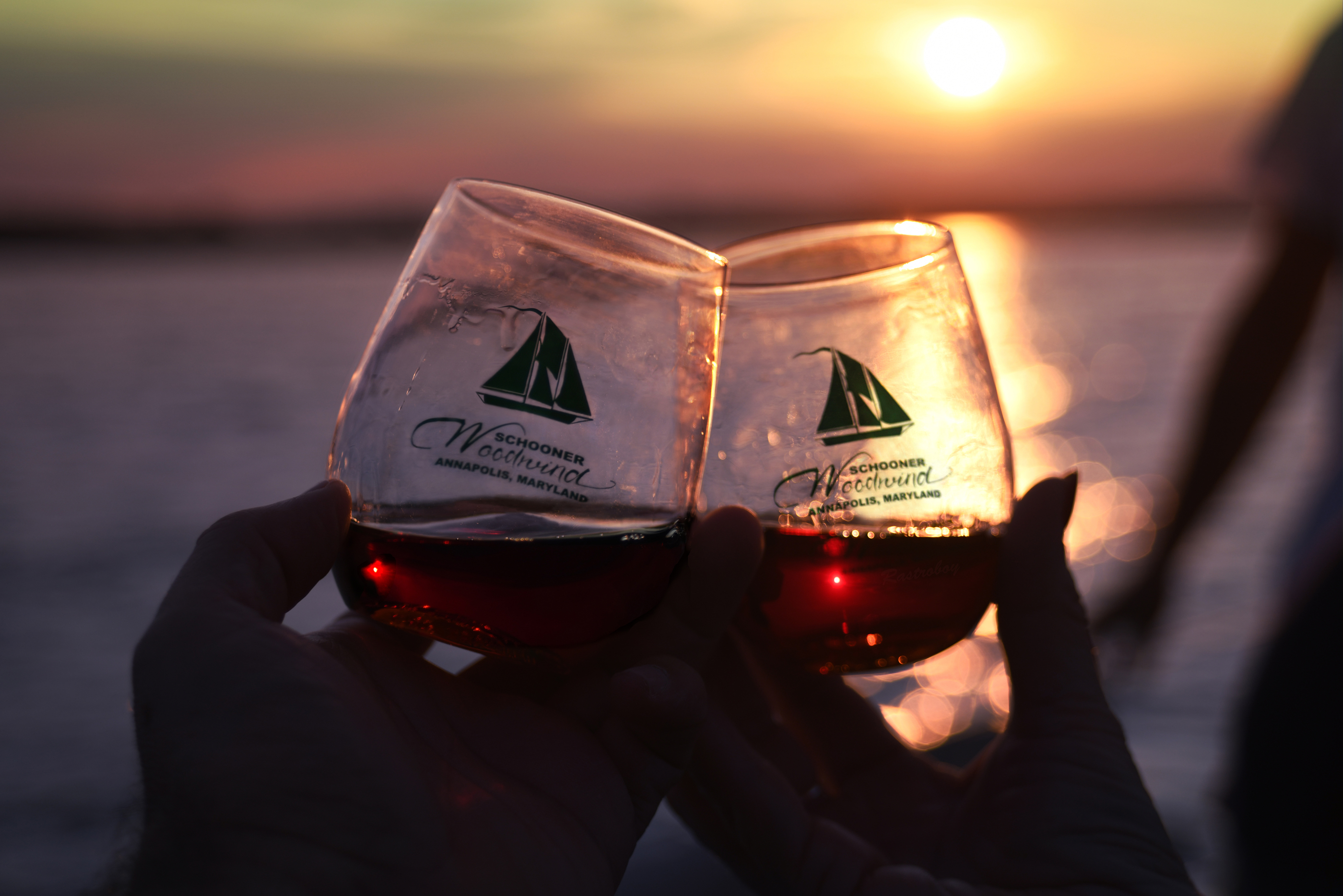 Two glasses of red wine at sunset