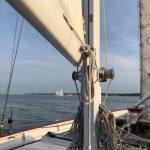 Mast and Sail of schooner looking through to blue skies ahead