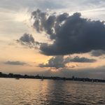 Dark clouds and water over Annapolis with sun peering through
