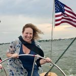 Women steering the helm and smiling on her 40th Birthday