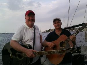 Don & Don smiling with their guitars