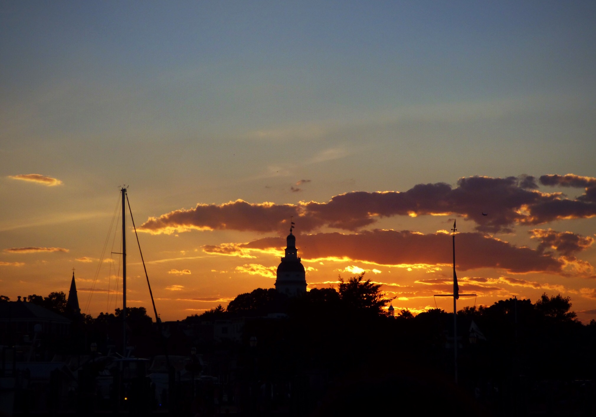 Annapolis Capital dome silhouetted in sunset with clouds